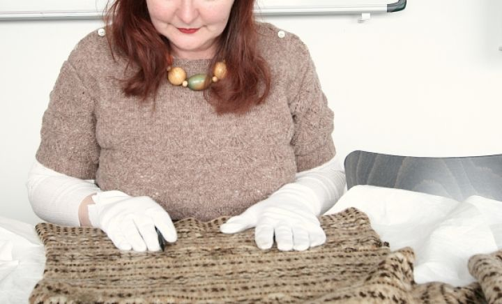 Susan studying knitwear in the Shetland Museum